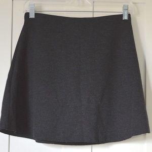 Dark gray skirt.